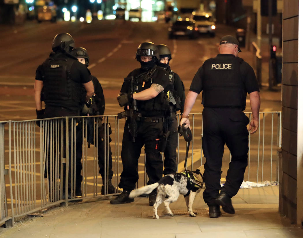 Armed police work after an explosion at the Manchester Arena in Manchester, England Tuesday, May 23, 2017. An explosion struck an Ariana Grande concert attended by thousands of young music fans in ...