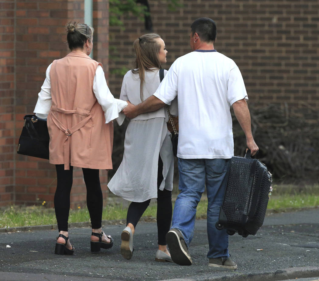 A fan leaves with parents at the Park Inn hotel in central Manchester, England Tuesday May 23 2017.  An apparent suicide bomber set off an improvised explosive device that killed over a dozen peop ...