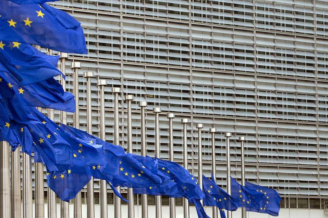 European Union flags blow in the wind at half-staff outside EU headquarters in Brussels on Tuesday, May 23, 2017. The flags were set at half-staff to remember those killed and injured in the attac ...