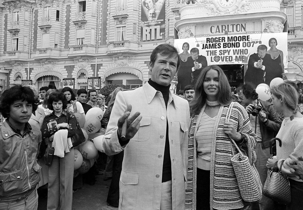 "Actor Roger Moore, alias British secret agent James Bond, is accompanied by co-star Barbara Bach as they arrive for the screening of their latest 007 feature, ""The Spy Who Loved Me,"" during the Ca ..."