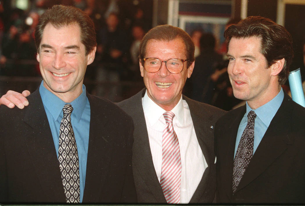 "Three of the actors who played James Bond, Timothy Dalton left, Roger Moore and Pierce Brosnan, at a London cinema to celebrate the life of Albert R. ""Cubby"" Broccoli, the American film producer b ..."