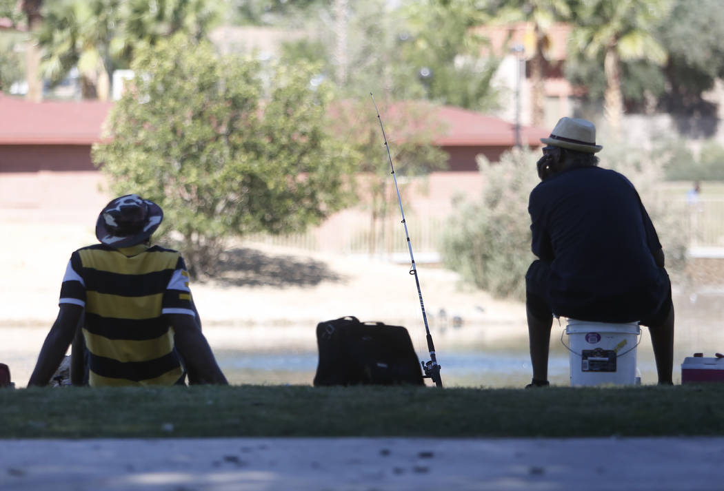 Mark Dickson, left, and his friend Jerald Clifton relax while fishing in a pond at Lorenzi Park on Tuesday, May 23, 2017, in Las Vegas. (Bizuayehu Tesfaye/Las Vegas Review-Journal) @bizutesfaye