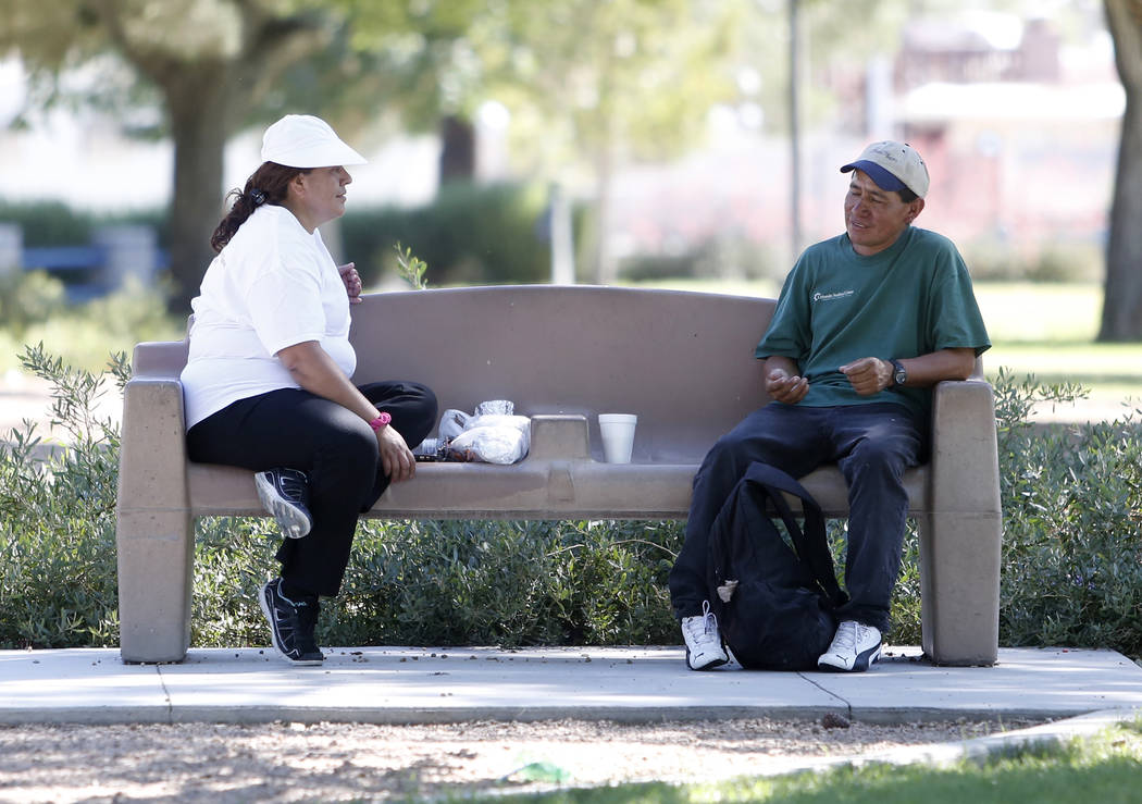 A couple, who declined to give their names, relax at Lorenzi Park on Tuesday, May 23, 2017, in Las Vegas.  (Bizuayehu Tesfaye/Las Vegas Review-Journal) @bizutesfaye