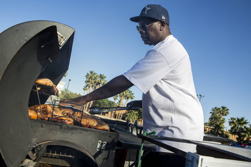 "Walter Buchanan, a Houston native, barbecues in the Las Vegas Arts District on Tuesday, May 23, 2017. By day, Buchanan offers ""professional services"" such as tax prep and notariz ..."