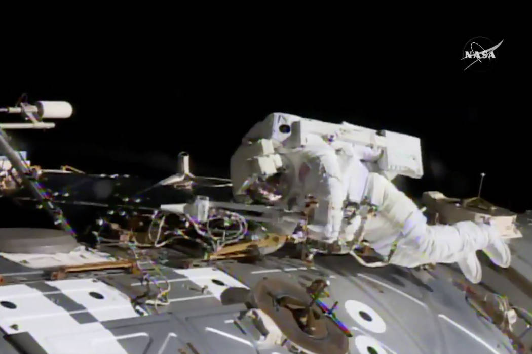 In this NASA provided frame from video, NASA astronaut Jack Fischer works to install antennas at the International Space Station while astronaut Peggy Whitson, not pictured, works on repairs Tuesd ...