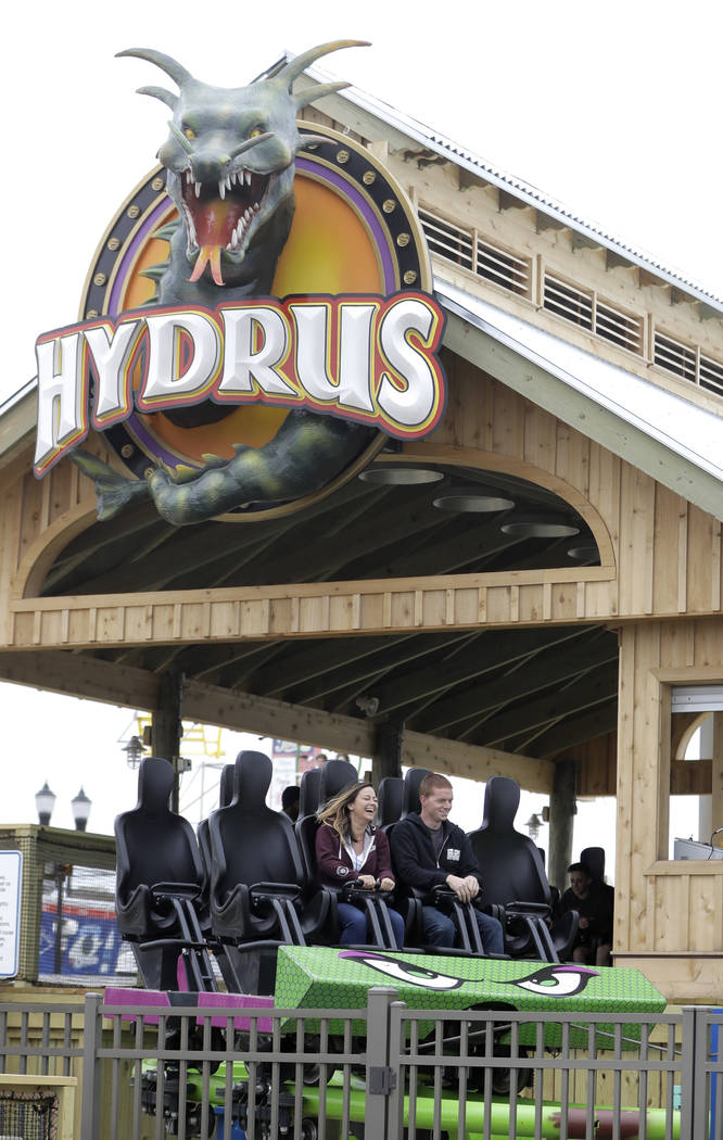 People ride the Hydrus roller coaster, Saturday, May 20, 2017, at Casino Pier in Seaside Heights, N.J.  (Julio Cortez/AP)