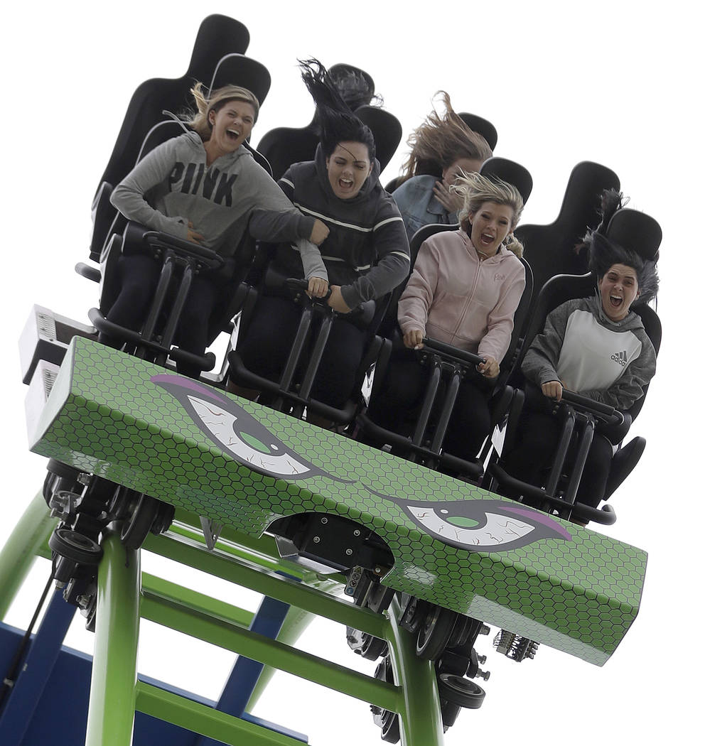 People react as they go over a hairpin drop while riding the Hydrus roller coaster at Casino Pier in Seaside Heights, N.J. on May 20, 2017. (Julio Cortez/AP)
