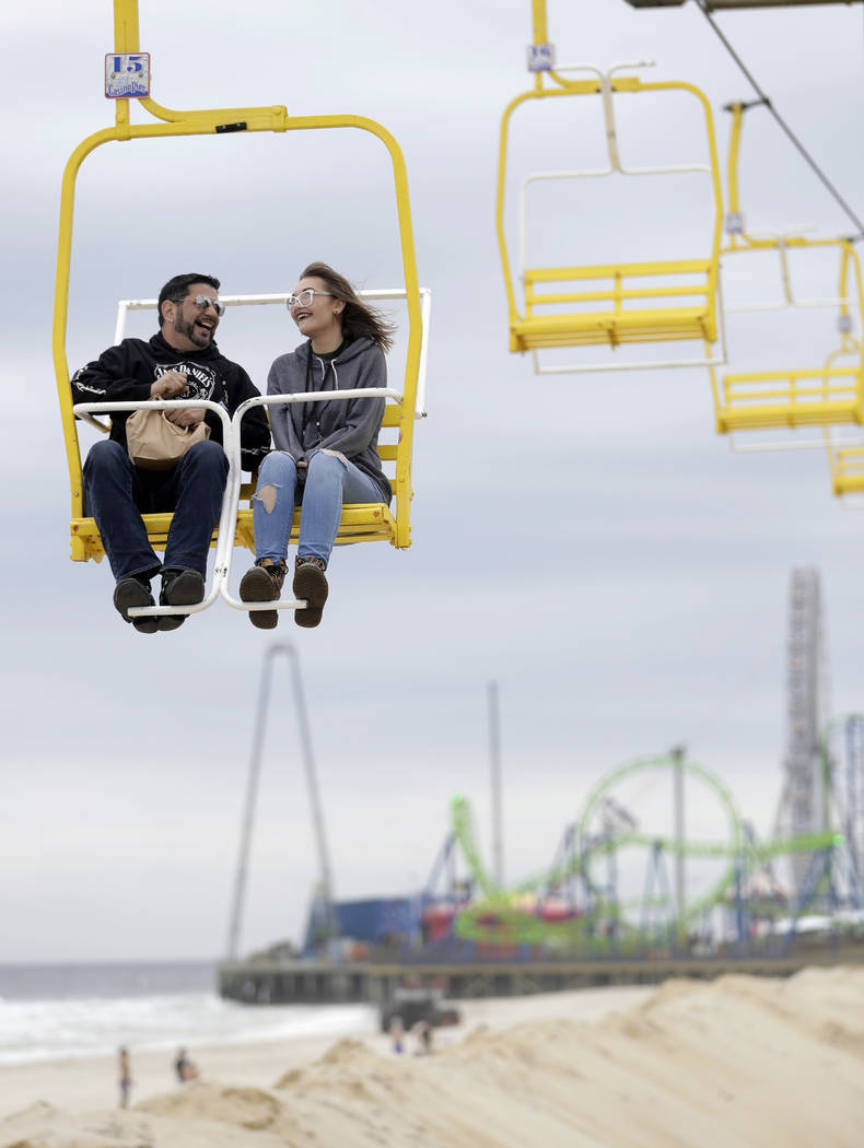People riding a chair lift converse as the new Hydrus roller coaster, bottom, is seen at a distance at Casino Pier in Seaside Heights, N.J. on May 20, 2017. (Julio Cortez/AP)