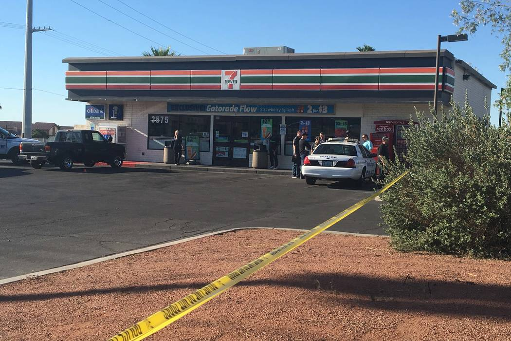 An armed man was shot and killed inside a 7-Eleven store at East Lake Mead Boulevard and Pecos Road early Monday morning, May 22, 2017. (Bizuayehu Tesfaye/Las Vegas Review-Journal) @bizutesfaye