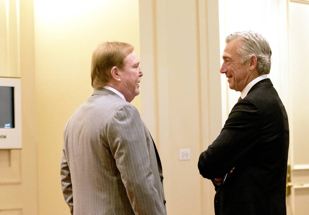 Oakland Raiders owner Mark Davis, left, speaks with NFL executive vice president Eric Grubman at the NFL owners meeting in Chicago, Ill., at the JW Marriott on Tuesday, May 23, 2017. Heidi Fang/La ...