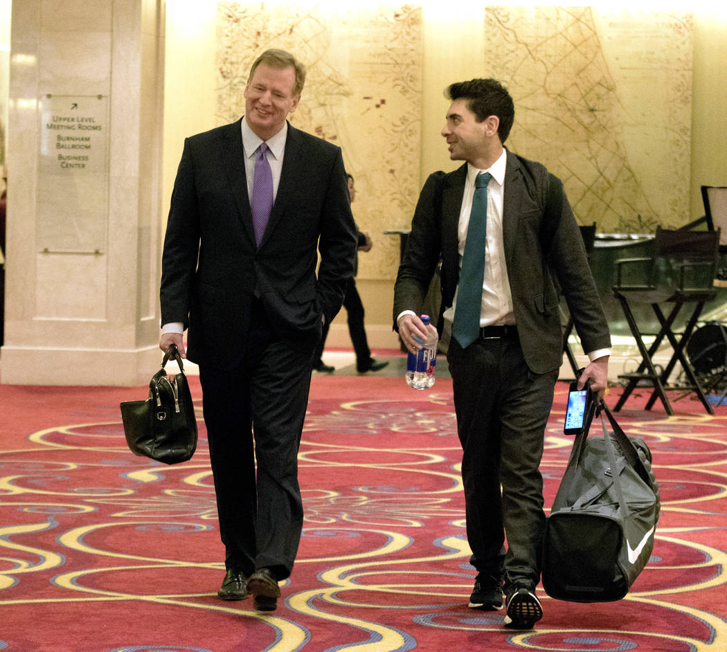 NFL commissioner Roger Goodell, left, arrives at the owners meeting in Chicago, Ill., where he's greeted by Jacksonville Jaguars senior vice president Tony Khan on Tuesday, May 23, 2017. Heidi Fan ...