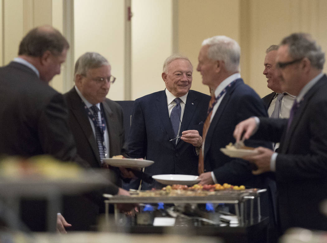 Dallas Cowboys owner Jerry Jones, center, meets with his colleagues during a break at the NFL owners meeting at the JW Marriott hotel in Chicago, Ill., on Tuesday, May 23, 2017. Heidi Fang/Las Veg ...