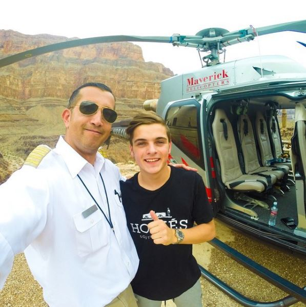 Joe Munoz of Maverick Helicopters with DJ Martin Garrix. (Courtesy)