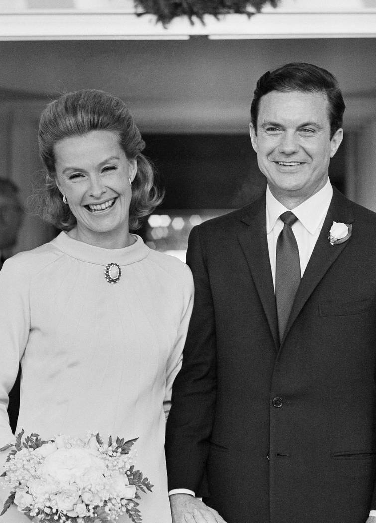 Actress Dina Merrill, left, and actor Cliff Robertson appear at their wedding Dec. 21, 1966, at the palatial estate of her mother, cereal heiress Marjorie Meriwether Post, in Washington. (Henry Bu ...