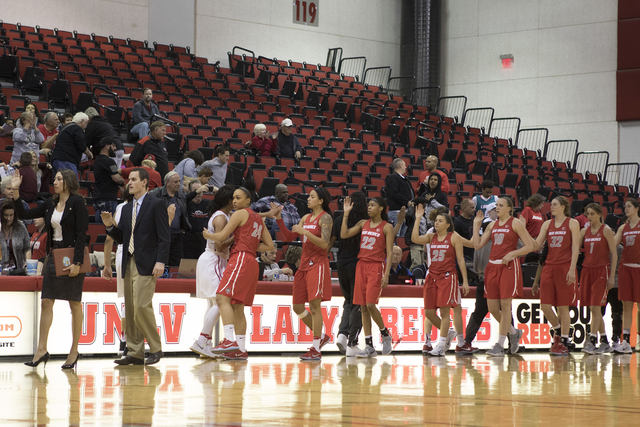 The New Mexico Lobos women's basketball team congratulates the UNLV Lady Rebels on their 56-42 win at the Cox Pavilion on Jan. 11, 2017. (Heidi Fang/Las Vegas Review-Journal) @HeidiFang