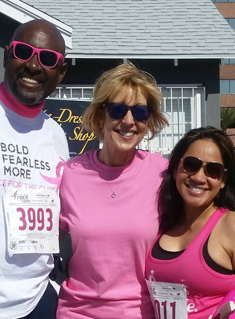 Chapman Lawrence and Gloria Ennis flank KLAS-TV weatherwoman Sherry Swensk during the annual Susan G. Komen Race for the Cure on May 6 in downtown Las