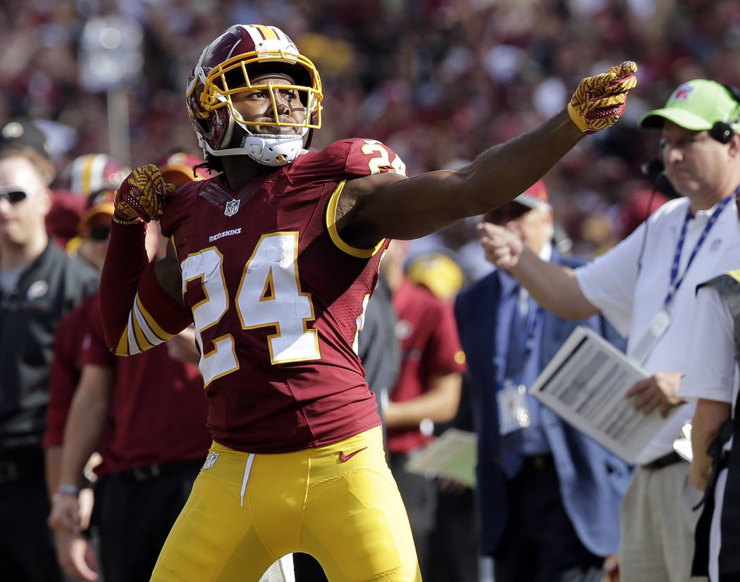"FILE - In this Oct. 2, 2016, file photo, Washington Redskins cornerback Josh Norman (24) celebrates his interception with a ""bow and arrow,"" gesture during the second half of an  ..."