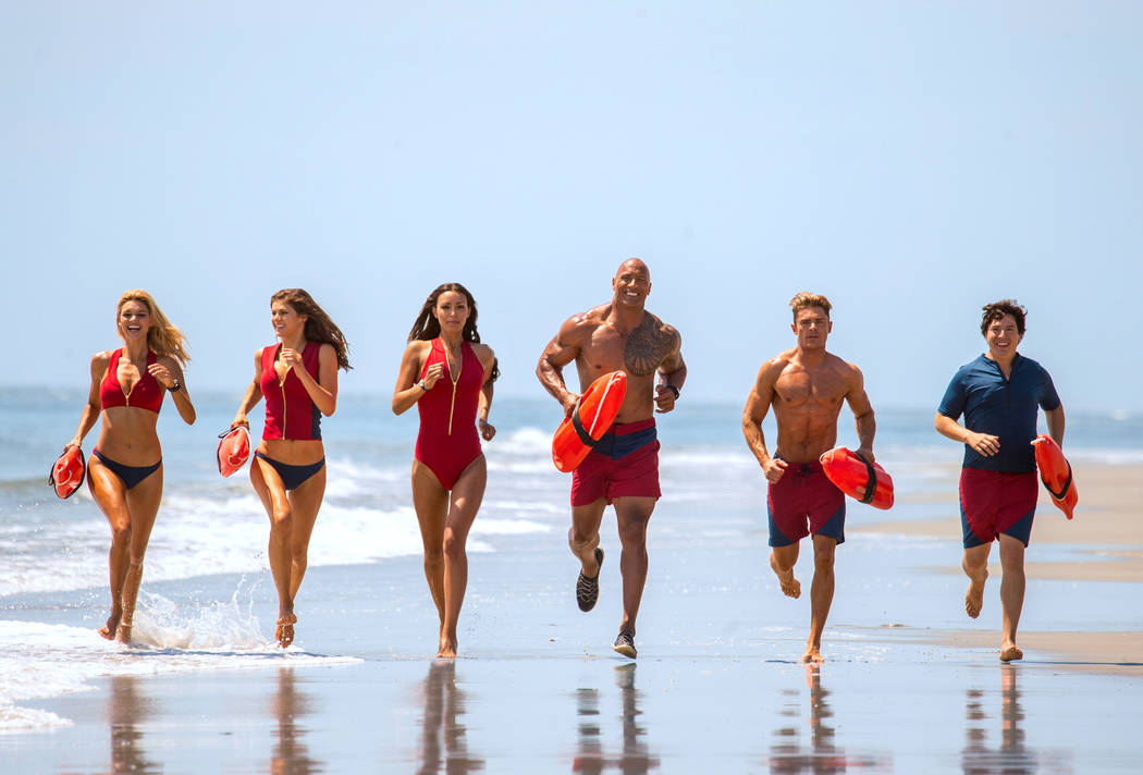 Kelly Rohrbach as CJ Parker, Alexandra Daddario as Summer, Ilfenesh Hadera as Stephanie Holden, Dwayne Johnson as Mitch Buchannon, Zac Efron as Matt Brody and Jon Bass as Ronnie in the film, Baywa ...
