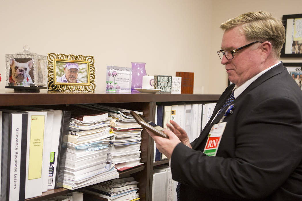 "Chief nursing officer John Coldsmith grabs his ""Nurses Choice Award"" at his office at Centennial Hills Hospital on Wednesday, May 24, 2017, in Las Vegas. (Bridget Bennett/Las Vegas Review-Journal) ..."