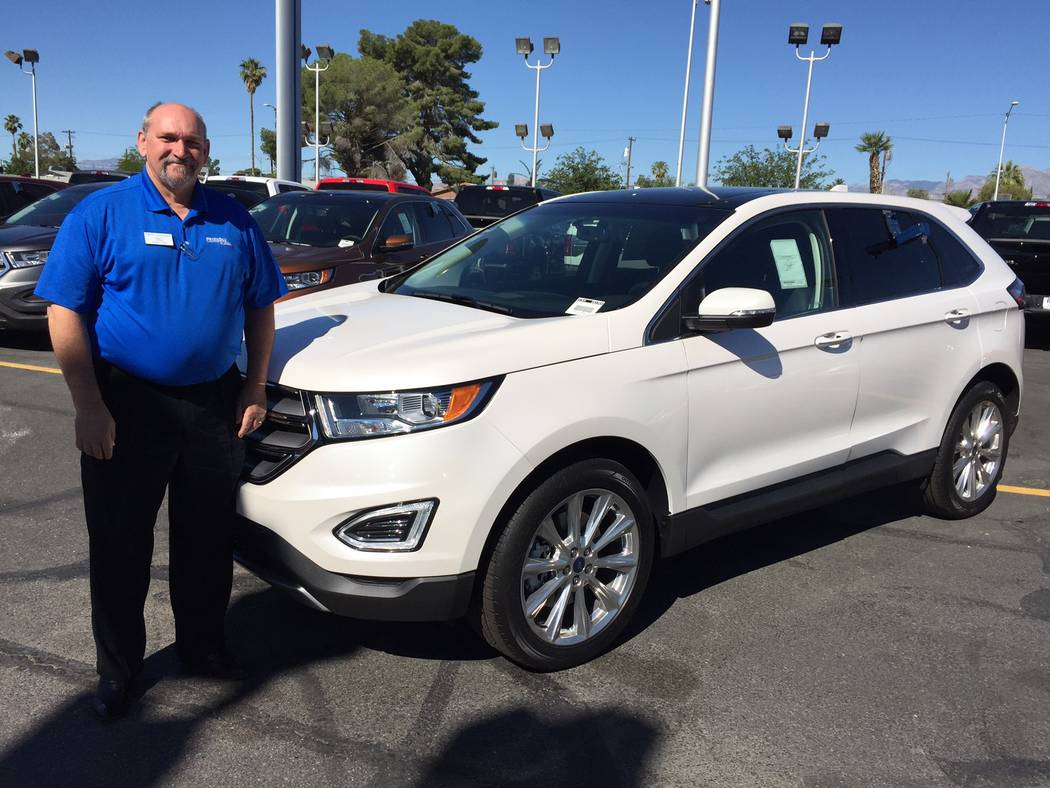 Friendly Ford Friendly Ford sales truck manager Matt Cavaness shows off a 2017 Ford Edge SUV at the dealership situated at 660 N. Decatur Blvd.