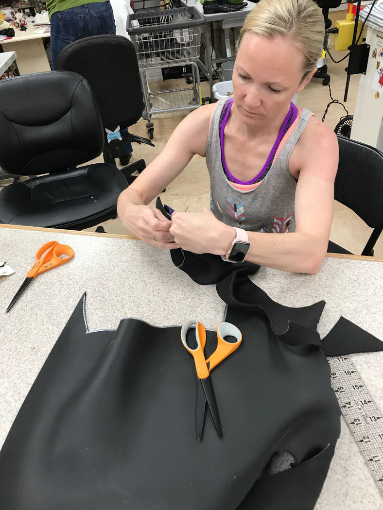 Brynn Coseru, a Cirque du Soleil synchronized swimmer, creates the hand fins she made as part of the requirements for her master's degree  in occupational therapy degree at Touro University.  Phot ...