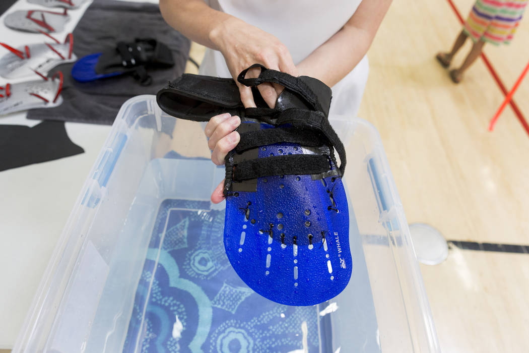 Brynn Coseru, occupational therapy student and a synchronized swimmer for Cirque du Soleil, explains her adaptive swim aid at Touro University, Wednesday, May 24, 2017. Elizabeth Brumley Las Vegas ...