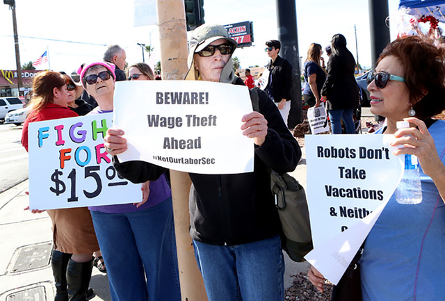 Residents and workers join a fighting for minimum wage protest outside a fast food restaurant in Las Vegas on Monday. A bill was introduced at the state Legislature that, if passed, would raise th ...