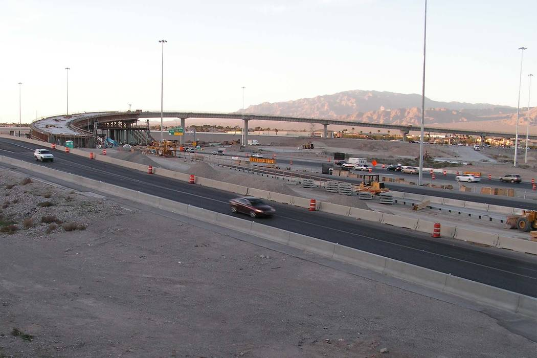 Cars proceed south on U.S. Highway 95 through construction at the Centennial Bowl, an interchange under construction at the northern I-215 beltway in Las Vegas on Monday, March 13, 2017. The flyov ...