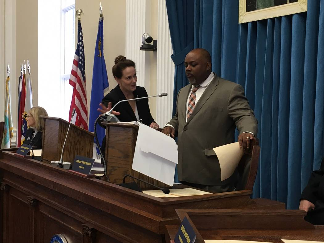 Assembly Speaker Jason Frierson, D-Las Vegas, confers with Chief Clerk Susan Furlong as he prepares to preside over the Assembly floor session in the Capitol on Wednesday, March 22, 2017, in Carso ...