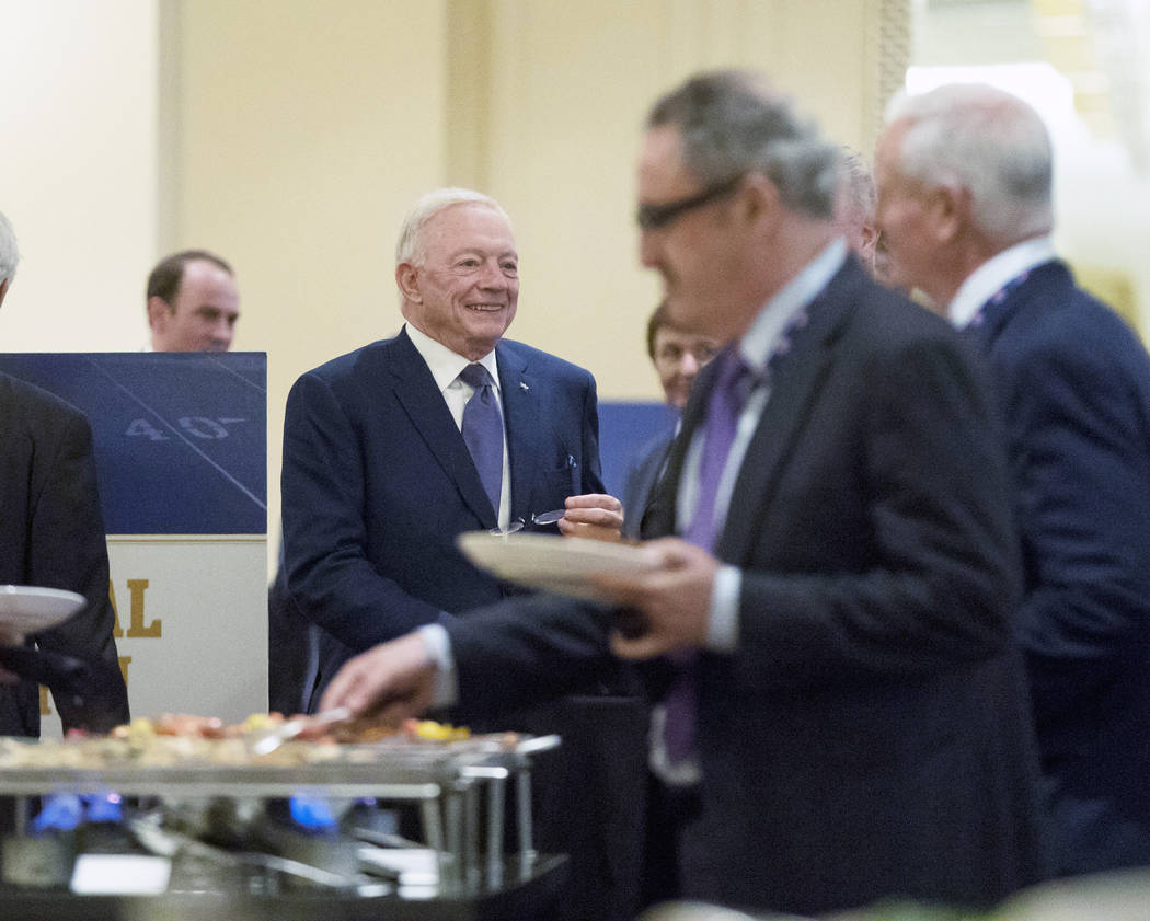 Dallas Cowboys owner Jerry Jones, left, walks out to the buffet area at the NFL owners meeting at the JW Marriott hotel in Chicago, Ill., on Tuesday, May 23, 2017. (Heidi Fang/Las Vegas Review-Jou ...