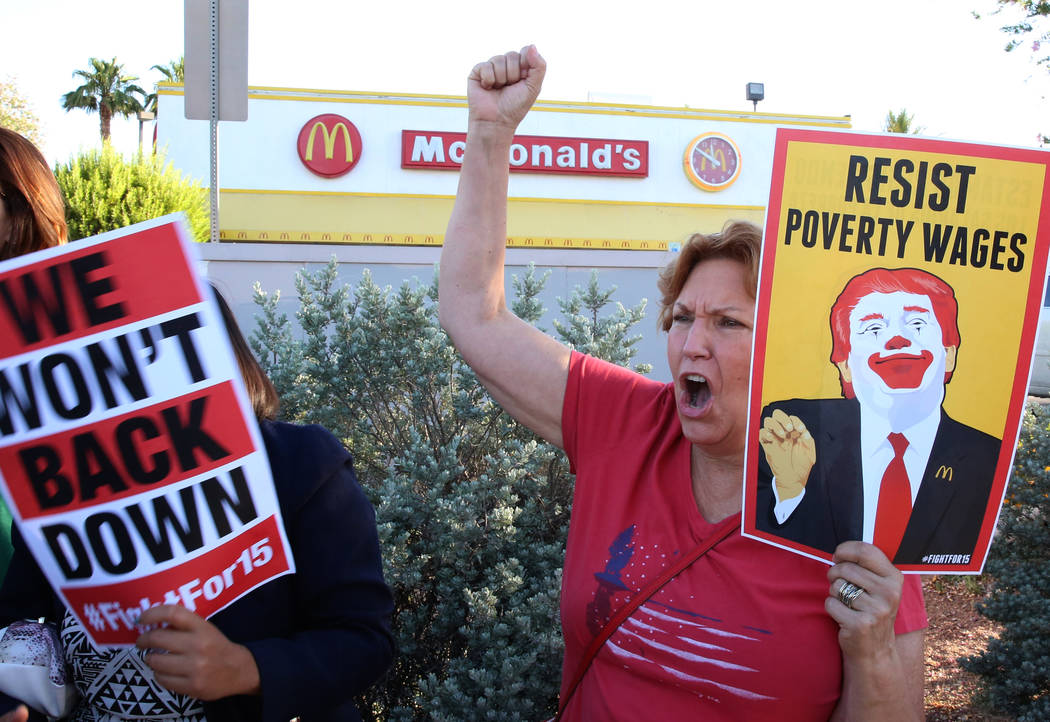 Erica Mosca, left, and Donna West join McDonald's franchise employees to protest for a higher minimum wage outside of a McDonald's on 2650 W. Sahara Ave., on Wednesday, May 24, 2017, in Las Vegas. ...