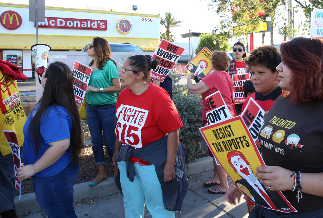 McDonald's franchise employees and their families protest for a higher minimum wage outside of a McDonald's on 2650 W. Sahara Ave., on Wednesday, May 24, 2017, in Las Vegas. Bizuayehu Tesfaye Las  ...