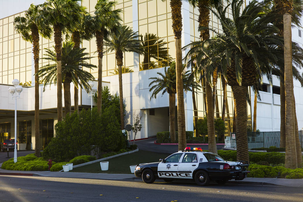 A Las Vegas police squad car sits outside of the Trump International after a suspect started a small fire in a bathroom at the hotel in Las Vegas on Wednesday, April 26, 2017. (Chase Stevens/Las V ...