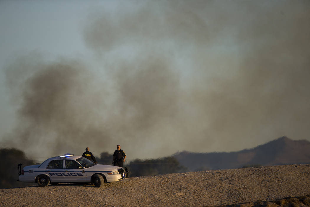 Sunset Park police assist as Clark County firefighters respond to a brush fire at Sunset Park in Las Vegas on Tuesday, May 23, 2017. Chase Stevens Las Vegas Review-Journal @csstevensphoto