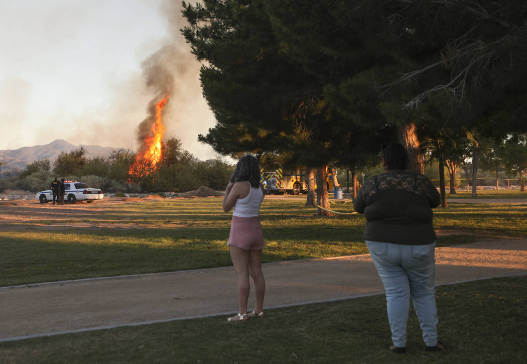 People watch a brush fire at Sunset Park in Las Vegas on Tuesday, May 23, 2017. Chase Stevens Las Vegas Review-Journal @csstevensphoto