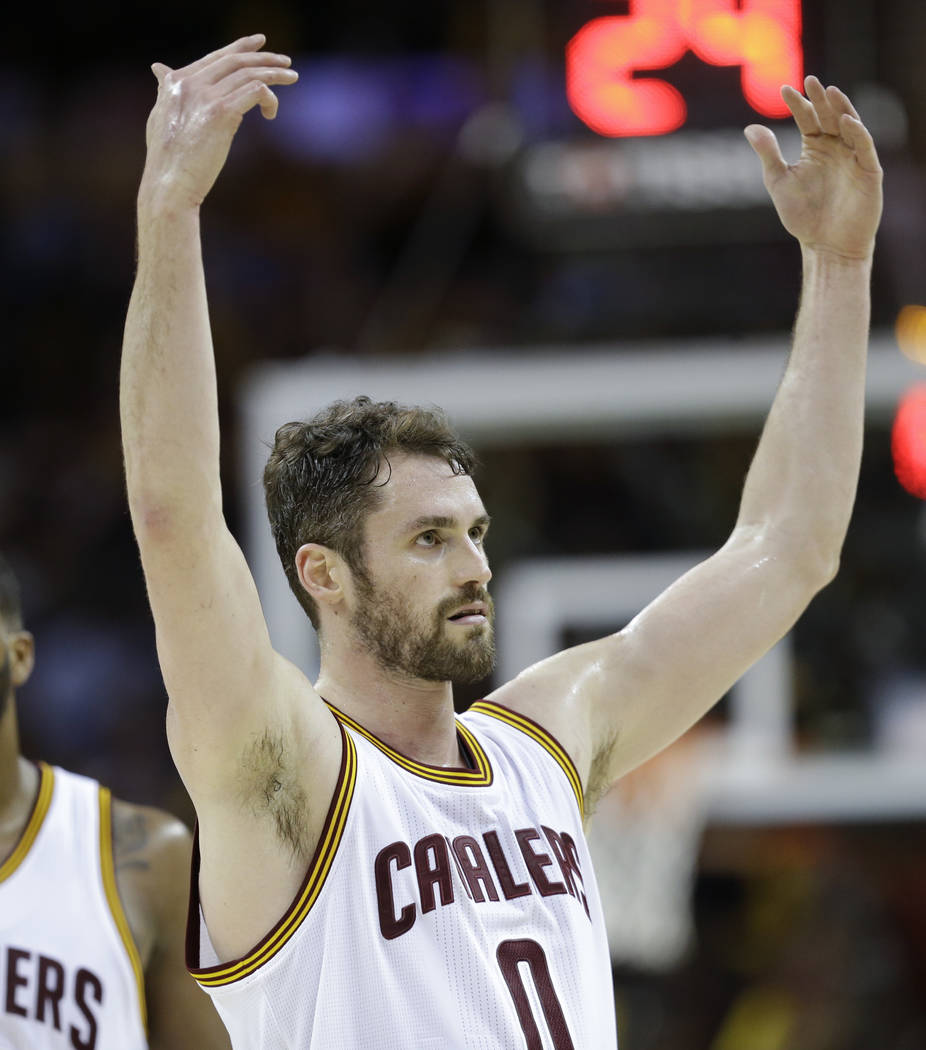 Cleveland Cavaliers' Kevin Love (0) jesters to the crowd during the second half of Game 4 of the NBA basketball Eastern Conference finals against the Boston Celtics, Tuesday, May 23, 2017, in Clev ...