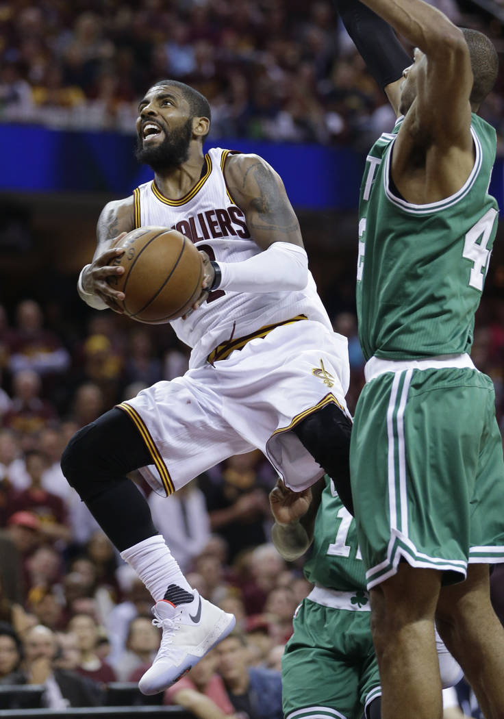 Cleveland Cavaliers' Kyrie Irving (2) goes up for a shot against Boston Celtics' Al Horford (42), from Dominican Republic, during the second half of Game 4 of the NBA basketball Eastern Conference ...