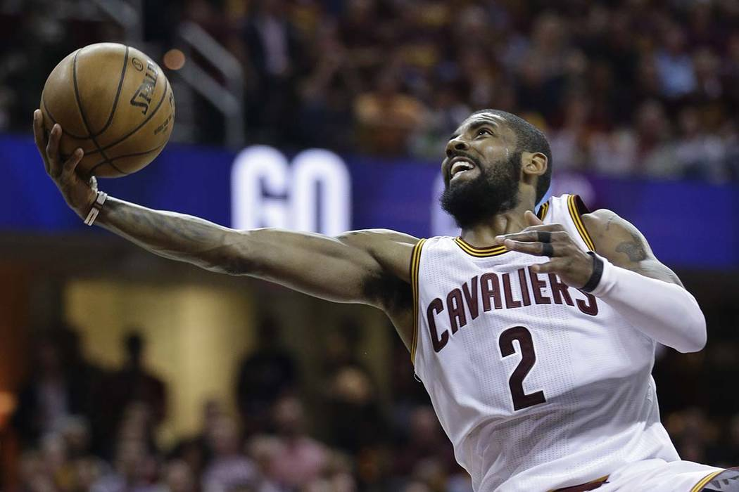 Cleveland Cavaliers' Kyrie Irving (2) puts up a shot against the Boston Celtics during the second half of Game 4 of the NBA basketball Eastern Conference finals, Tuesday, May 23, 2017, in Clevelan ...