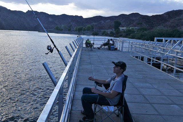 Hyrum Nielsen settles in for an evening of fishing at Willow Beach. Trout plants will resume Feb. 3 at this popular fishery. (Doug Nielsen/Special to Review-Journal)