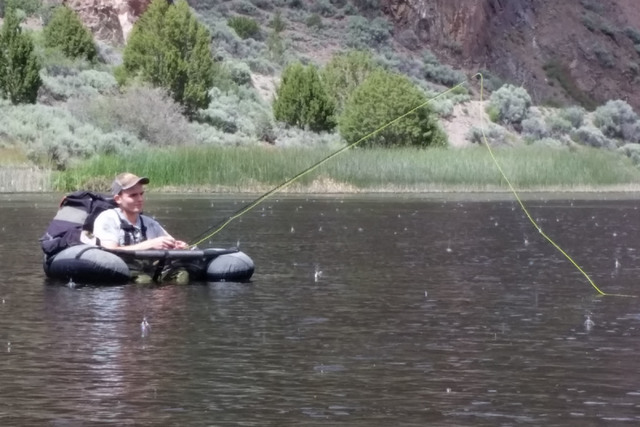 Hyrum Nielsen searches the waters of Eagle Valley Reservoir for trout during a recent outing to the Lincoln County water. The reservoir holds three species of trout and largemouth bass. (C. Dougla ...