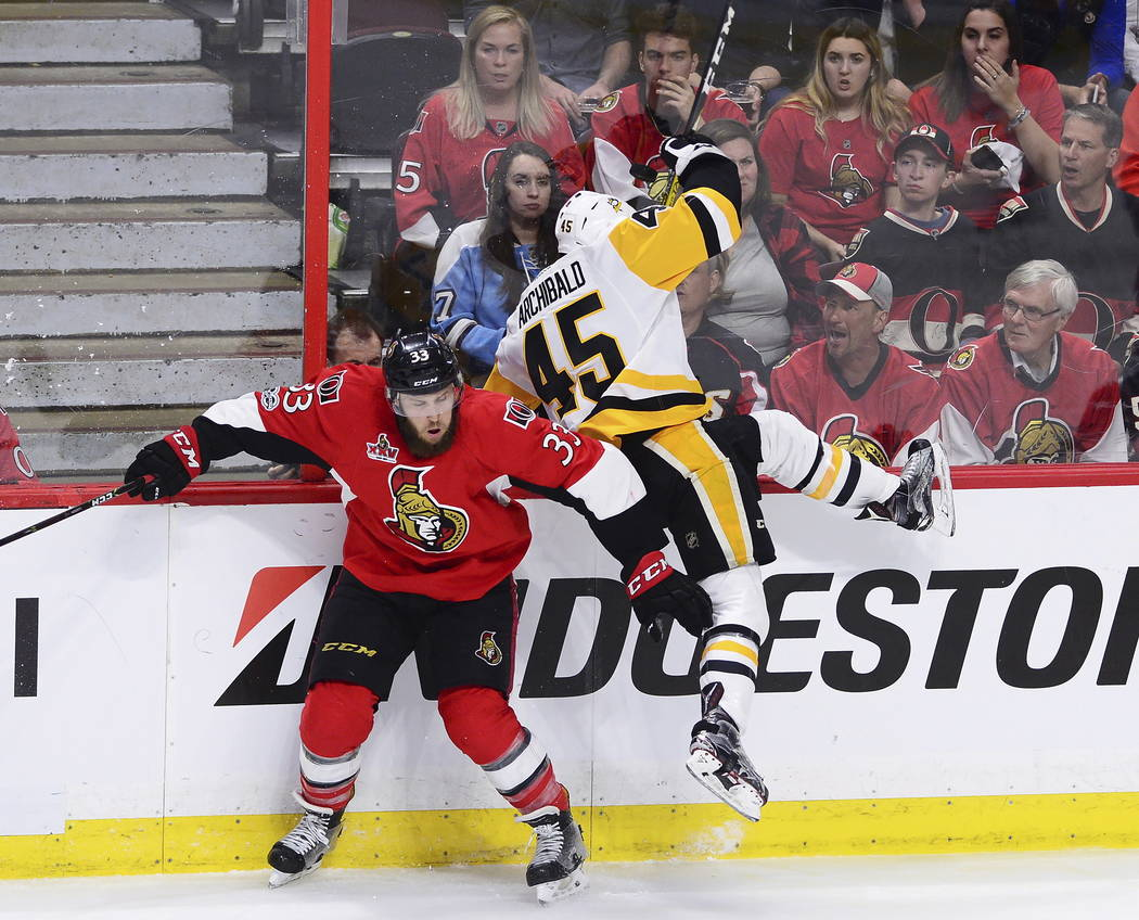 Ottawa Senators defenseman Fredrik Claesson (33) collides with Pittsburgh Penguins right wing Josh Archibald (45) during the third period of game six of the Eastern Conference final in the NHL Sta ...