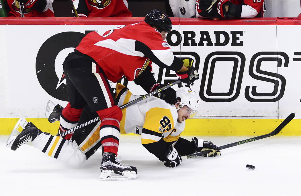 Ottawa Senators defenseman Marc Methot (3) takes down Pittsburgh Penguins center Sidney Crosby (87) during the third period of game six of the Eastern Conference final in the NHL Stanley Cup hocke ...