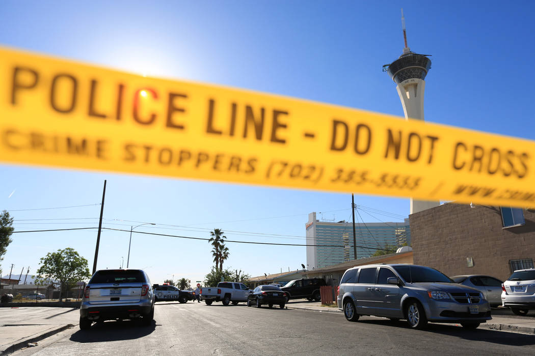 Crime scene tape blocks off the intersection of Chicago Avenue and Fairfield Avenue as police investigate a shooting on Thursday, May 4, 2017, in Las Vegas. (Brett Le Blanc Las Vegas Review-Journa ...