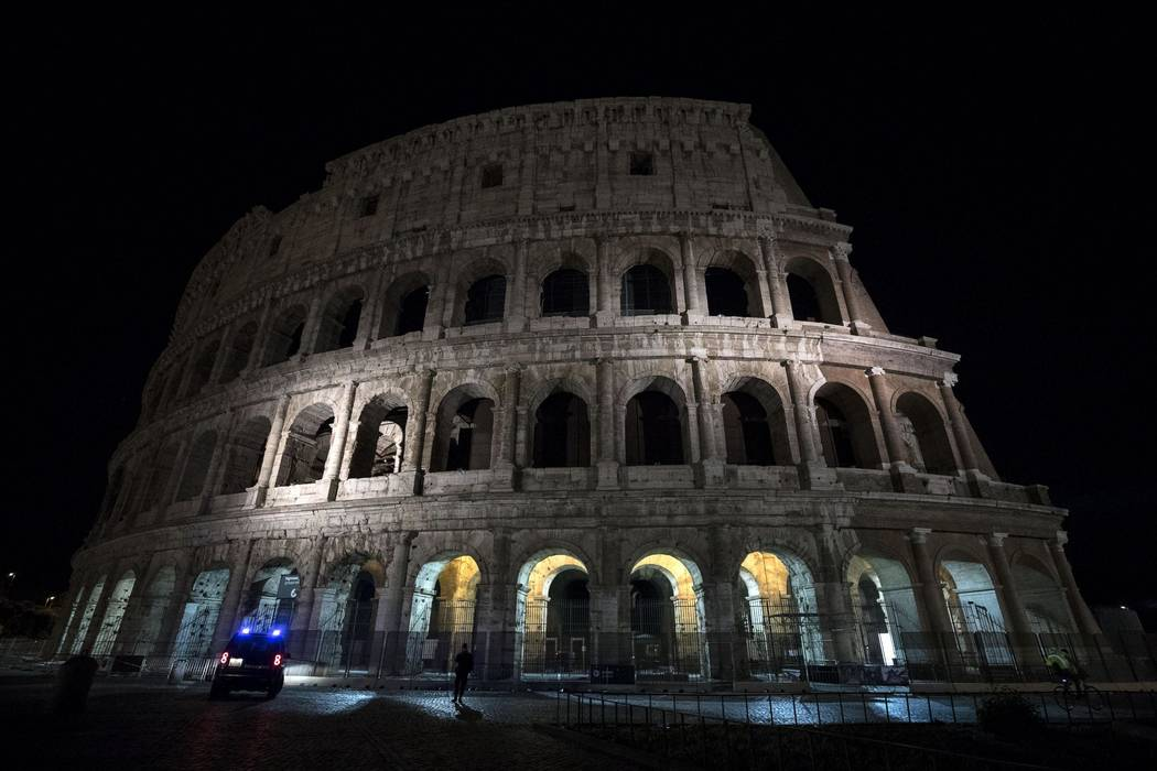 In this photo taken on Tuesday, May 23, 2017 the lights are off at the ancient Colosseum in Rome. Rome turned off the lights of the Colosseum, Trevi Fountain and city Hall Palace to honor the vict ...