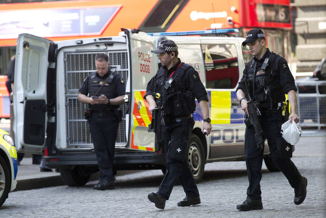 Armed police officers patrol outside at St Paul's Cathedral in London, Wednesday May 24, 2017 to mark the one hundredth anniversary of the Order of the British Empire. Britons will find armed troo ...