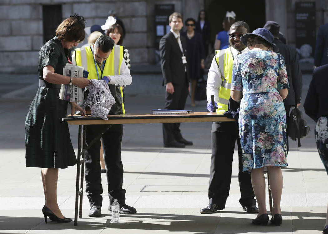 People have their bags searched outside St Paul's Cathedral in London, Wednesday May 24, 2017 ahead of a service to mark the one hundredth anniversary of the Order of the British Empire. Britons w ...