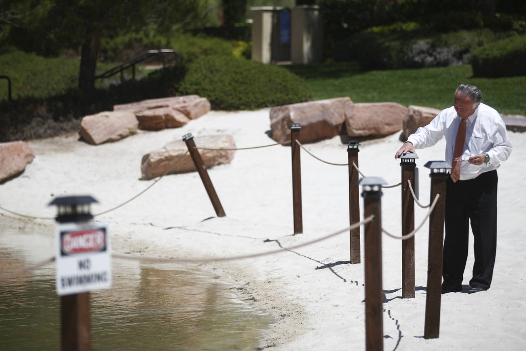 Sig Ortloff, general manager at Hilton Lake Las Vegas, checks the barrier blocking off the lagoon area at the resort in Henderson on Thursday, May 25, 2017. Chase Stevens Las Vegas Review-Journal  ...