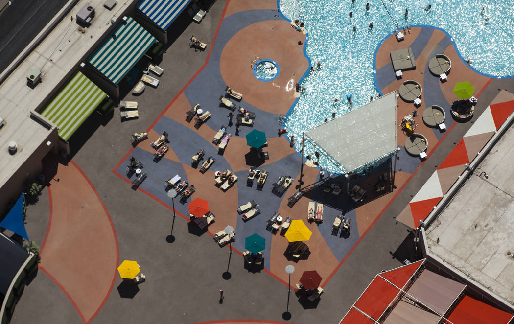 People cool off at the Stratosphere hotel-casino pool as temperatures approach 100 degrees in the Las Vegas Valley on Tuesday, May 23, 2017. Health district records for the past two years show the ...