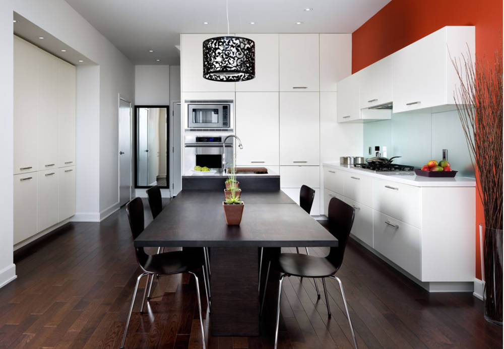 Houzz This modern kitchen features a little red and a lot of white.
