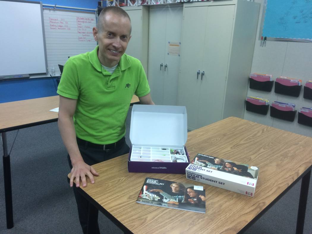 Jason Lillebo, fourth grade teacher at Edith Garehime Elementary School, stands in his classroom with a littleBits kit April 26, 2017. The kits allow students to come up with solutions to problems ...